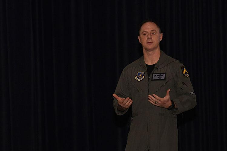 U.S. Air Force Col. Tad Clark, 8th Fighter Wing commander, speaks to members of the Wolf Pack about wing heritage at Kunsan Air Base, Republic of Korea, Feb. 7, 2020. Clark's recent visit to Vietnam inspired him to share his experience of the visit and of the wing's role during the Vietnam War. (U.S. Air Force photo by Staff Sgt. Anthony Hetlage)