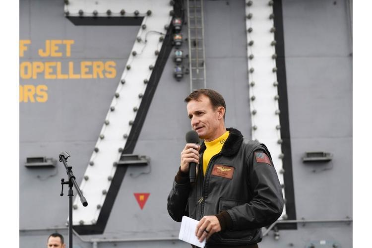 Capt. Brett Crozier, commanding officer of the aircraft carrier USS Theodore Roosevelt, addresses the crew during an all-hands call on the ship's flight deck on Nov. 14, 2019. NICHOLAS HUYNH/U.S. NAVY