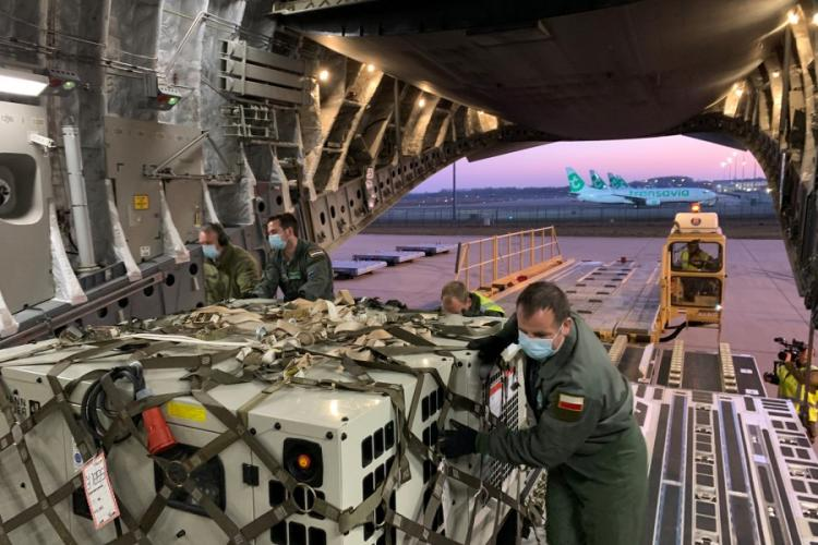 Crew members load mobile intensive care units for Saint Martin at Eindhoven Airport, Netherlands, April 5, 2020. ROYAL NETHERLANDS DEFENSE FORCES