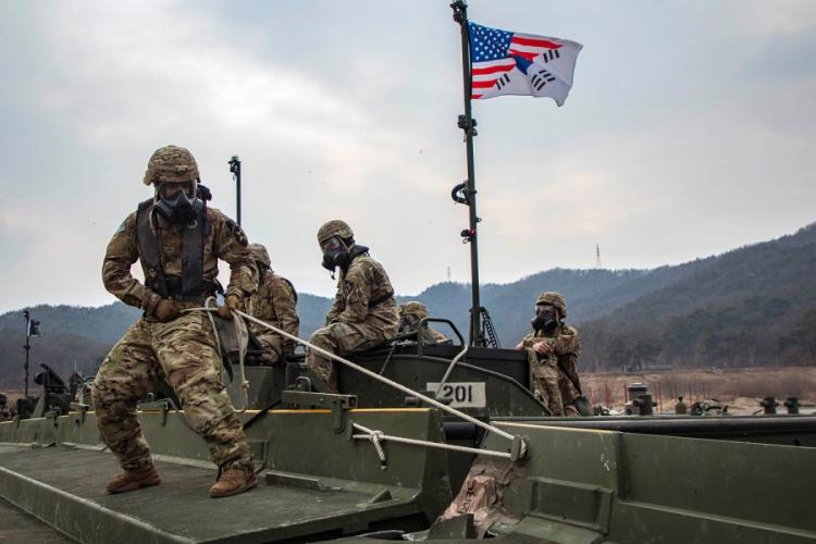 U.S. soldiers of the 2nd Infantry Division Sustainment Brigade connect a bridge section during a rafting exercise on Namhan River, South Korea, on Feb. 27, 2019. ADELINE WITHERSPOON/U.S. ARMY