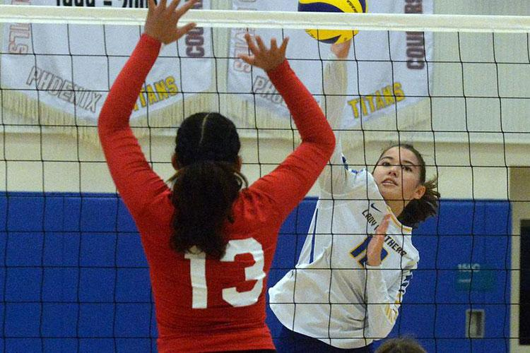 Yokota's Elena Haas spikes against Nile C. Kinnick's Cierra San Nicolas during Saturday's Japan girls volleyball match. The Red Devils won in straight sets. (Dave Ornauer/Stars and Stripes)