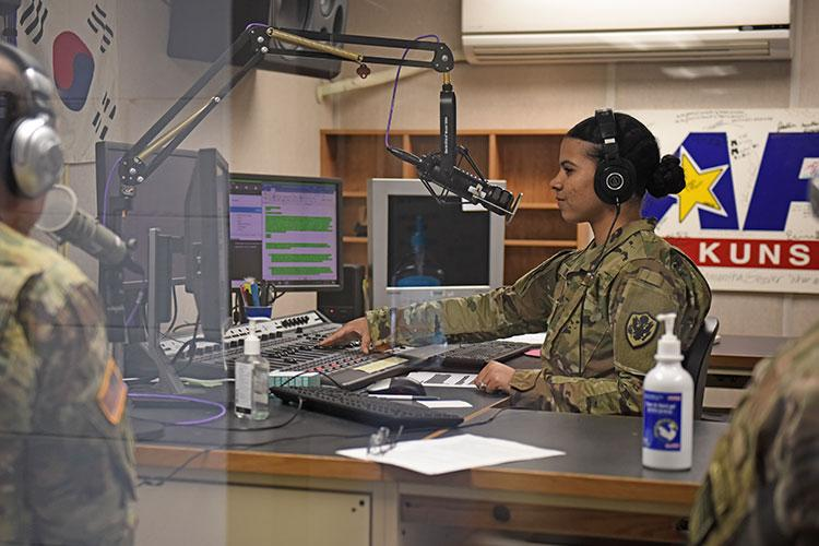 U.S. Air Force Staff Sgt. AJ Duprey, American Forces Network video NCO in charge, conducts a radio show at Kunsan Air Base, Republic of Korea, April 28, 2020. AFN Kunsan is a joint organization, helping commanders maintain readiness and morale through the dissemination of fun, engaging and informative content on the radio, social media and television. (U.S. Air Force photo by Staff Sgt. Mackenzie Mendez)
