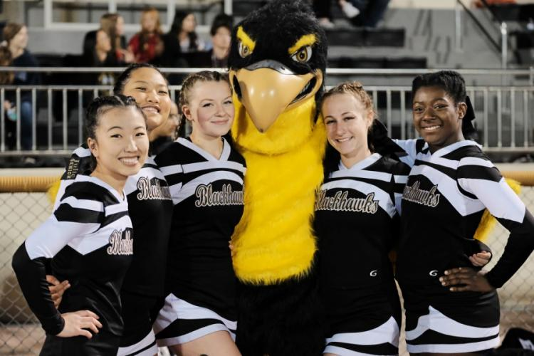 Senior Blackhawk cheerleaders pose with the school mascot, Russell Crouch, at Camp Humphreys, South Korea, Friday, Nov. 1, 2019. MATTHEW KEELER/STARS AND STRIPES