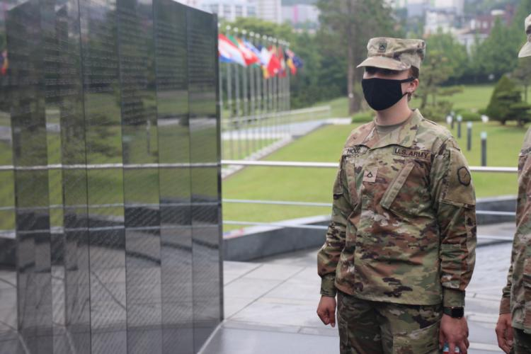 Spc. Rosemarie Hood, 25th Transportation Battalion, 19th Expeditionary Sustainment Command, reads the names inscribed on the Wall of Remembrance at United Nations Memorial Cemetery in Korea, May 18, 2021. Soldiers from 19th ESC visited the memorial as part of a spiritual resilience training event organized by the 19th ESC Chaplain's Office.