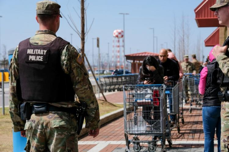 Customers wait to enter the commissary at Camp Humphreys, South Korea, Friday, March 27, 2020. Escalated health protection measures put limits on the number of people who can be inside the store at one time. MATTHEW KEELER/STARS AND STRIPES