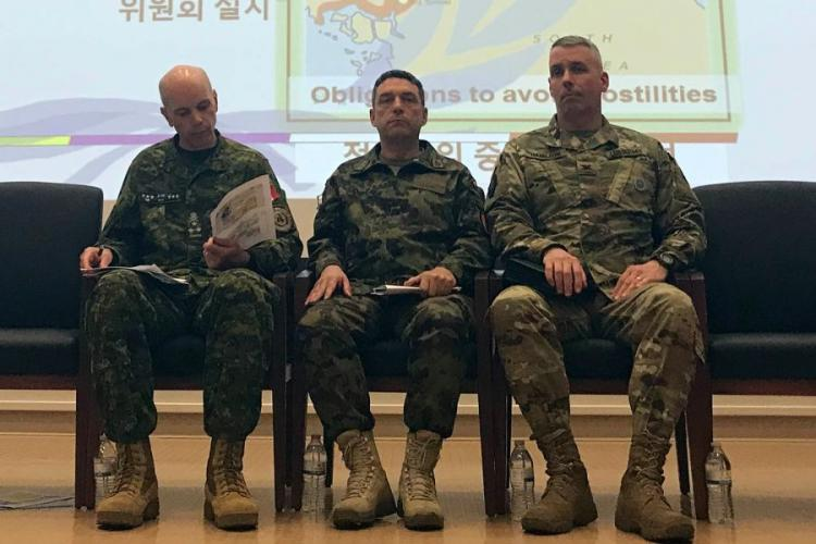 Canadian Lt. Gen. Wayne Eyre, left, deputy commander of the United Nations Command; Maj. Gen. Patrick Gauchat, center, head of the Swiss delegation to the Neutral Nations Supervisory Commission; and U.S. Army Col. Burke Hamilton, secretary of the UNC's military armistice commission, speak to reporters at the UNC headquarters on Camp Humphreys, South Korea, Thursday, April 18, 2019. KIM GAMEL/STARS AND STRIPES