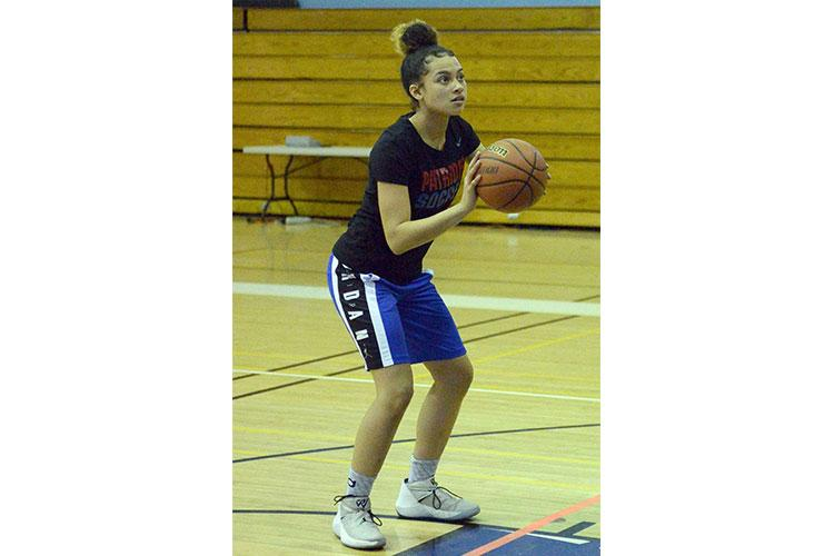 Mya Rolison, a sophomore transfer from Maryland, helps lead Seoul American girls in this weekend's Korea Plate Tournament fresh off her first triple-double of the season in the Falcons' 27-point win over Taejon Christian.  DAVE ORNAUER/STARS AND STRIPES
