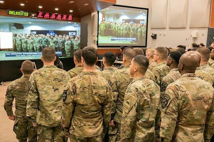 Soldiers assigned to the 2nd Infantry Division appear live during the Super Bowl LIII opening ceremony from Camp Humphreys, South Korea, Monday, Feb. 4, 2019.  MATT KEELER/STARS AND STRIPES