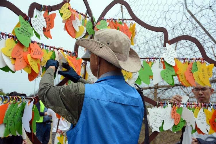 South Koreans place wishes for peace on a tree of hope erected on the Goseong DMZ Peace Trail, which was recently opened to civilians in the northeastern part of the heavily fortified border area. About 20 South Koreans participated in a hike on Friday, June 14, 2019. KIM GAMEL/STARS AND STRIPES