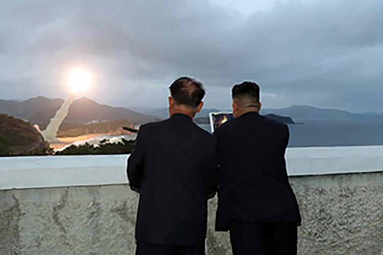 North Korean leader Kim Jong Un, right, watches a missile launch in this photo released by the Korean Central News Agency on Aug. 11, 2019. KCNA