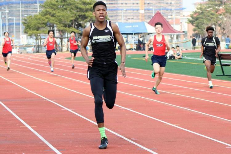 Humphreys' Tevijon Williams heads for the finish of the boys 200 during Saturday's Humphreys Invitational track and field meet. Williams won the 100 and 200 and ran the second leg of Humphreys' first-place 400-meter relay team. KRYSTAL DUENAS/SPECIAL TO STRIPES