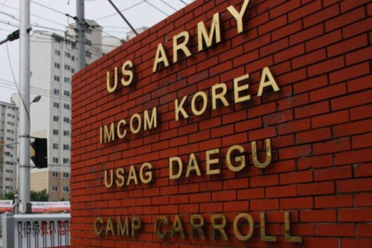 The entrance to Camp Carroll, South Korea, is shown in this undated file photo. STARS AND STRIPES