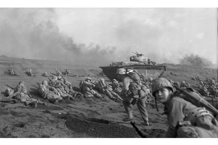 This undated photo from the National Archives depicts the Marine Corps' 27th Regiment, 2nd Battalion landing on Iwo Jima in 1945. BOB CAMPBELL/U.S. MARINE CORPS
