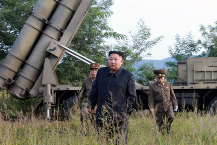 North Korean leader Kim Jong Un stands near a mobile launcher in this photo released by the Central Korean News Agency on Wednesday, Sept. 11, 2019. KCNA