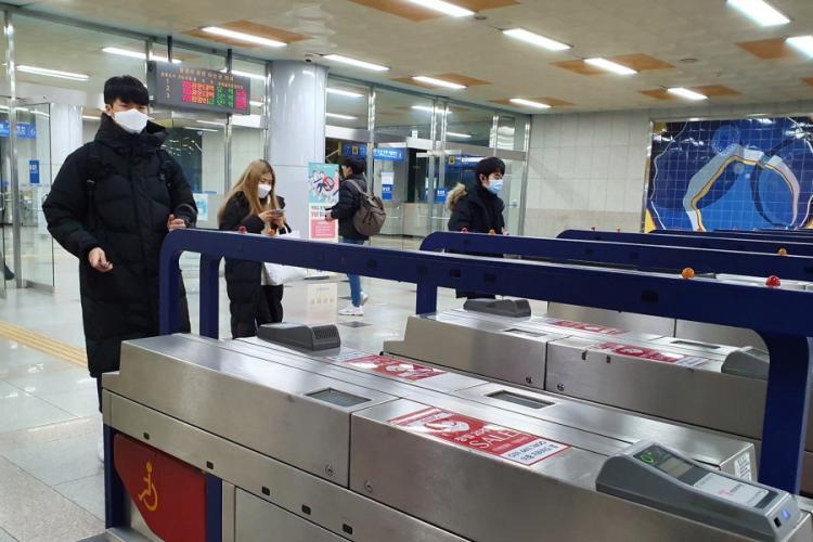 Masked commuters travel through Seojeong-ri Station, north of Pyeongtaek, South Korea, Monday, Jan. 27, 2020. MATTHEW KEELER/STARS AND STRIPES