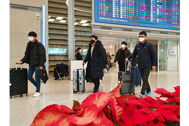 Airplane passengers exit an arrival gate wearing masks at Incheon International Airport, South Korea, Monday, Feb. 3, 2020. MATTHEW KEELER/STARS AND STRIPES
