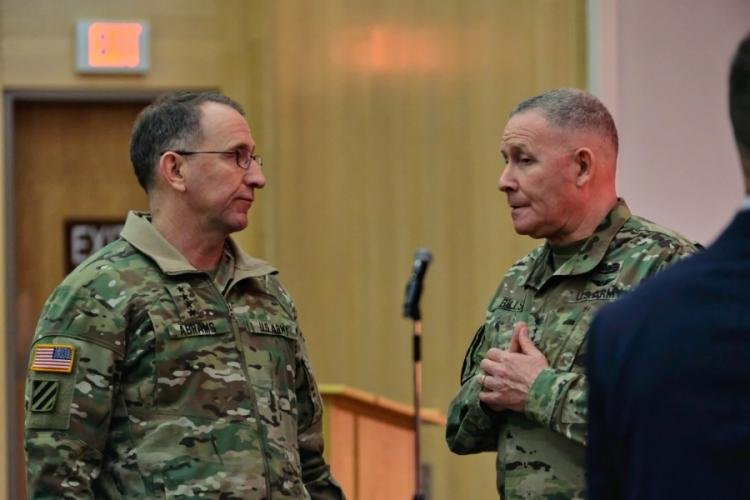 U.S. Forces Korea commander Gen. Robert Abrams and Eighth Army commander Lt. Gen. Michael Bills talk briefly following a town hall-style meeting at the Four Chaplains Memorial Chapel, Camp Humphreys, South Korea, Monday, Feb. 24, 2020. MATTHEW KEELER/STARS AND STRIPES