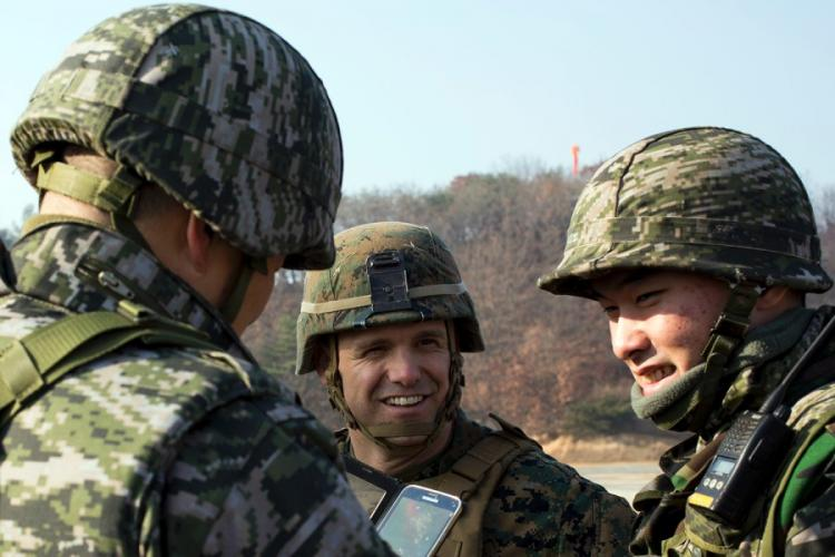 U.S. and South Korean marines socialize during a past joint training exercise in Pocheon, South Korea. ROBERT GONZALES/U.S. MARINE CORP