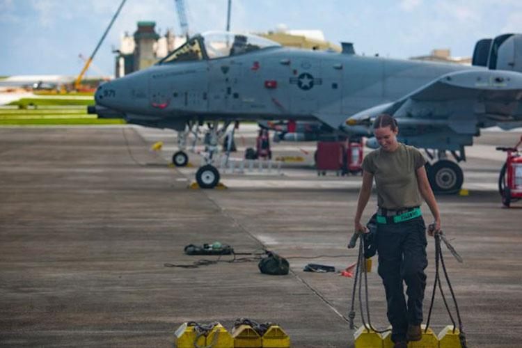 U.S. Air Force Airman 1st Class Cheyenne Loew, assigned to the 25th Aircraft Maintenance Unit (AMU), Osan Air Base (OAB), South Korea, prepares to receive an A-10 Thunderbolt II at Andersen Air Force Base, Guam, Aug. 17, 2020. The 25th AMU and the 25th Fighter Squadron, OAB, deployed to Andersen to conduct routine flight training, wingman tactics familiarization and air refueling. (U.S. Air Force photo by Senior Airman Michael S. Murphy)