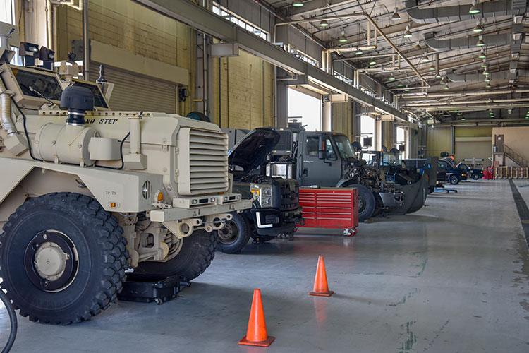 Vehicles assigned to the 8th Logistics Readiness Squadron vehicle management flight are lined up in a maintenance bay for repair at Kunsan Air Base, Republic of Korea, April 14, 2020. The ever-expanding fleet of vehicles includes 62 construction and sortie-generating vehicles, such as mission critical refueling trucks. (U.S. Air Force photo by Tech. Sgt. Joshua Arends)