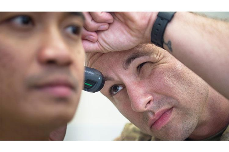 Senior Airman Jano Galinada is examined by Tech. Sgt. James Miller, an independent duty medical technician, in June 2019 at Joint Base Langley-Eustis, Virginia. (Air Force photo by Senior Airman Tristan Biese)
