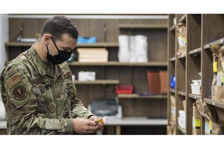 Air Force Airman 1st Class Gregory Maguire, a pharmacy technician with the 1st Special Operations Medical Support Squadron, processes a patient's prescription at Hurlburt Field, Florida. (Photo by Air Force Airman 1st Class Hailey M. Ziegler.)