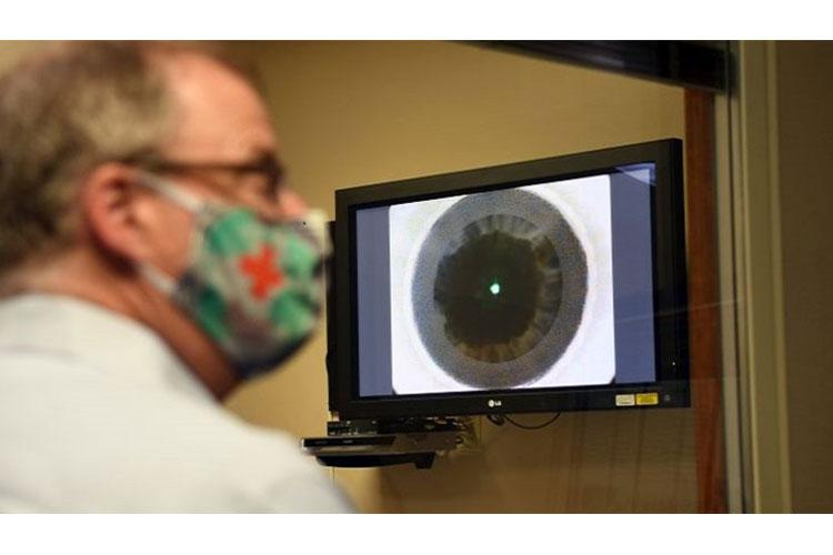 Assistant Secretary of Defense for Health Affairs Thomas McCaffery observes the beginning stages of a refractive surgery at the Warfighter Refractive Surgery Center at Joint Base San Antonio-Lackland, Oct. 21. The center is the largest refractive training program in the Department of Defense and has trained and certified more than 150 refractive surgeons. (Photo by Air Force St. Sgt. Amanda Stanford, 59th Medical Wing.)