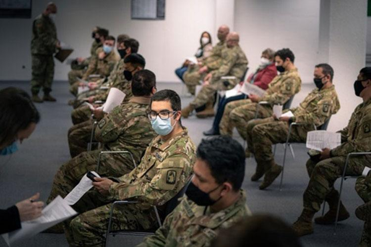 U.S. Army Soldiers from 1st Battalion, 214th Aviation Regiment, 12th Combat Aviation Brigade, go through questions and instructions prior to receiving their second COVID-19 vaccine on Feb. 24, in Wiesbaden, Germany (Photo by: Army Maj. Robert Fellingham, 12th Combat Aviation Brigade).