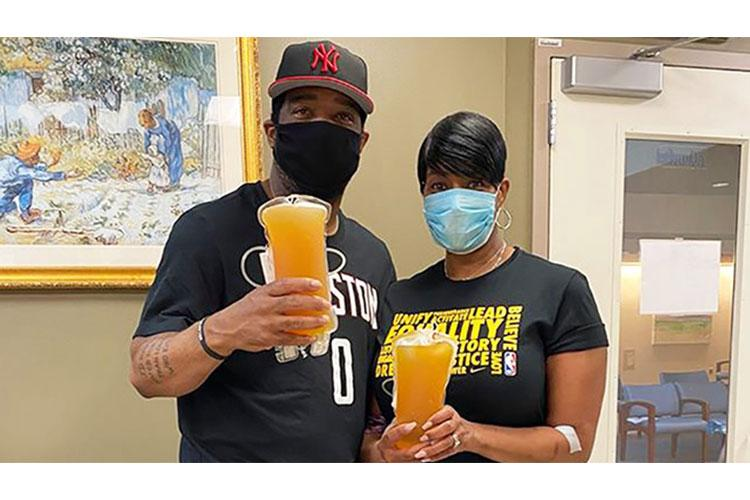 Retired Air Force Chief Master Sgt. Trae King-Latimer and her husband Jerome Latimer believe they contracted COVID-19 around the time of their first-year wedding anniversary. After fully recovering from COVID-19, they wanted to help those still fighting the disease and donated convalescent plasma together. (Courtesy Photo)