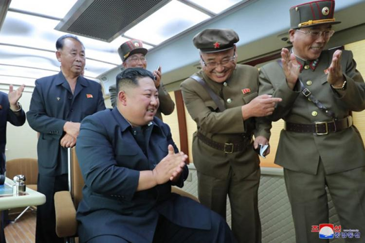 """This undated photo, released by the state-run Korean Central News Agency on Aug. 17, 2019, shows North Korean leader Kim Jong Un observing the test-firing of a """"new weapon,"""" according to KCNA. KCNA"""