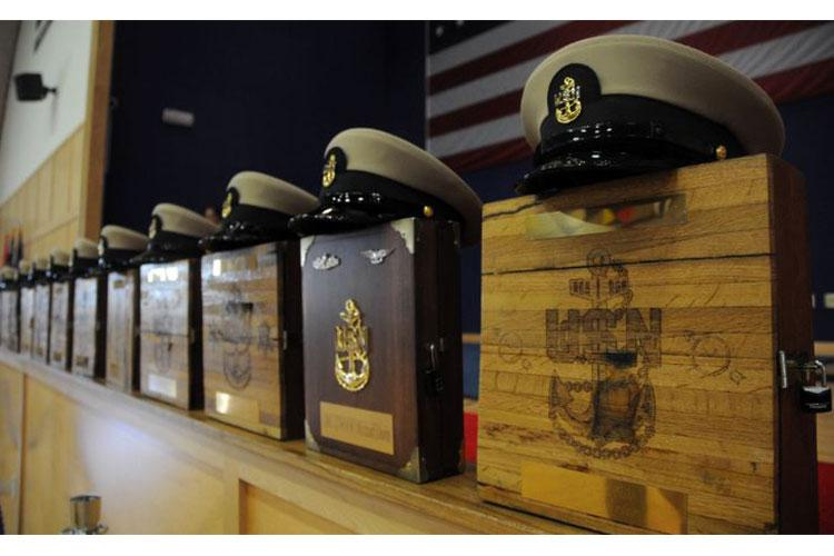 NEWPORT, R.I. (Sept. 13, 2019) Chief petty officer (CPO) combination covers and charge book vessels line the stage before the Naval Station (NAVSTA) Newport FY-20 CPO pinning ceremony. Seventeen Sailors stationed at commands throughout NAVSTA Newport were pinned to the rank of CPO during the ceremony. (U.S. Navy photo by Senior Chief Mass Communication Specialist Michael A. Lantron/Released)