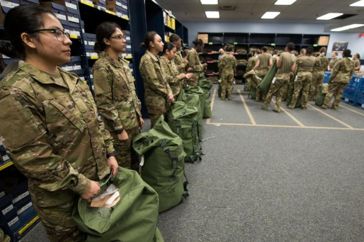 Air Force basic military trainees of the 326th Training Squadron receive the first operational camouflage pattern uniforms during initial issue Oct. 2, 2019, at Joint Base San Antonio-Lackland, Texas. SARAYUTH PINTHONG/U.S. AIR FORCE