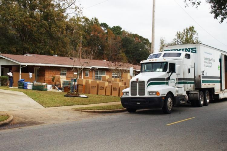 A moving truck is unloaded as a family moves into their new home. DEPARTMENT OF DEFENSE
