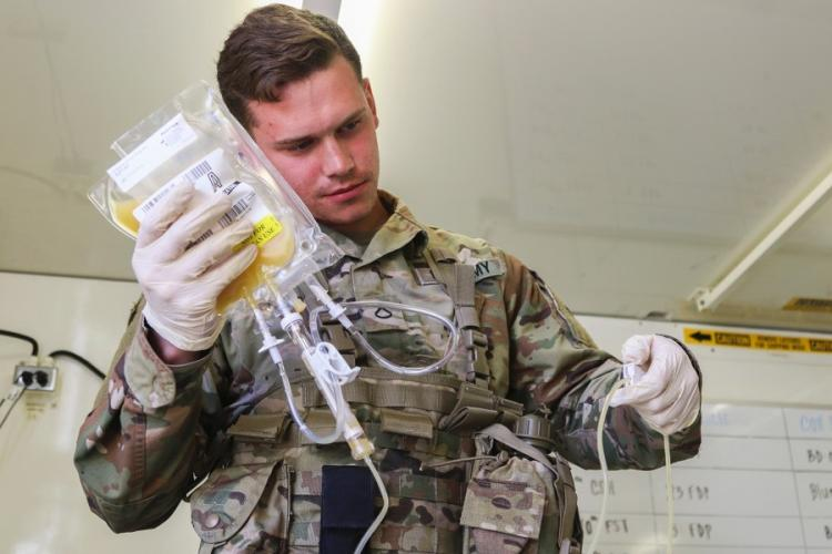 Pfc. Jaritt Louthan, a medical lab technician, works with freeze-dried plasma at Fort Bragg, N.C. The Defense Department announced on Wednesday, Feb. 19, 2020, that of the 50 facilities designated for some level of restructuring, 37 outpatient clinics now open to all beneficiaries will eventually see primarily active-duty personnel. BRIAN MICHELICHE/U.S. ARMY