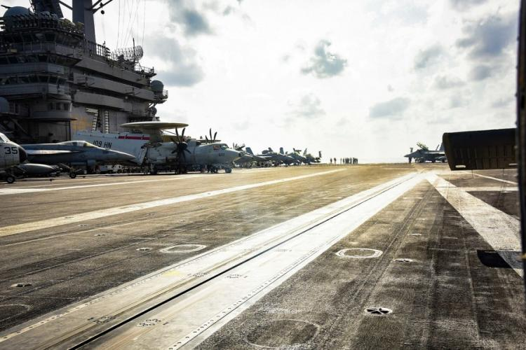 Sailors work on the flight deck of the USS Theodore Roosevelt (CVN 71) March 18, 2020, while transiting the Philippine Sea. On Wednesday, April 1, the Navy said it is working to move most of the crew off the aircraft carrier because of a coronavirus outbreak on the ship. BRANDON RICHARDSON/U.S. NAVY
