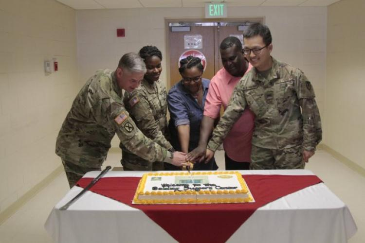 The Soldier Support Center Grand Opening May 14 included a cake cutting ceremony. The opening of the SSC symbolizes the garrison's commitment to the community. USAG Daegu provides world class services to Soldiers, civilians, retirees and their Family members in Area IV. (Photo Credit: Pvt. Alaura Lucas)