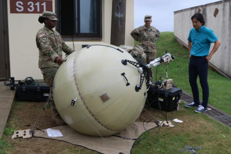 Almost done: A team from the 2nd Infantry Division and 19th Expeditionary Sustainment Command Logistics Transition Team trainers aim their Inflatable Satellite Antenna in the direction of a satellite at U.S. Army Garrison-Humphreys July 25. A two-week training course was conducted to give Soldiers and civilians the tools to train their personnel on the new ISA system. (U.S. Army photo by Pfc. Sung, Jun-Woong/Eighth Army Public Affairs) (Photo Credit: Kenji Thuloweit)
