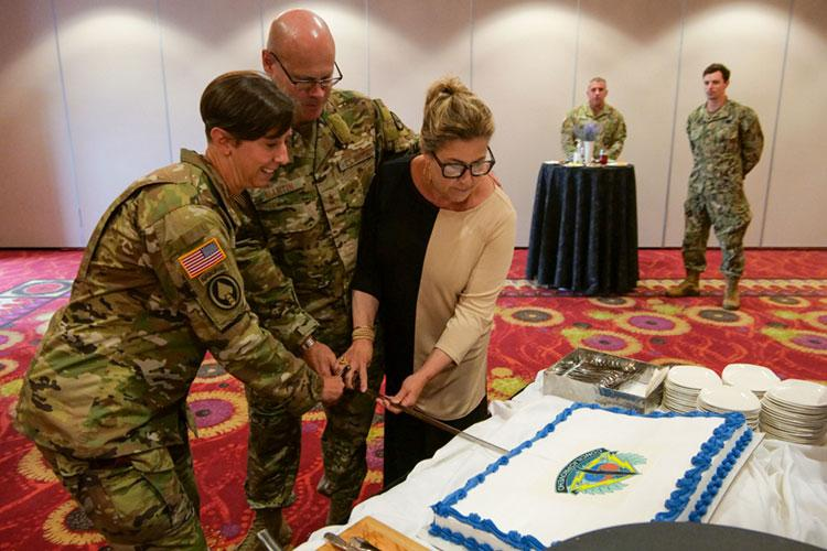 U.S. Air Force Maj. Gen. Michael E. Martin (center), Special Operations Command commander, his wife Cynthia (right), and Command Sgt. Maj. JoAnn Naumann (left), SOCKOR senior enlisted leader, cut a SOCKOR cake at a reception following the SOCKOR Change of Command Ceremony at the Riverbend Golf Club June 23, 2021. Martin is the 18th commander in SOCKOR's 32-year history and Naumann is the unit's 13th senior enlisted leader. (U.S. Air Force photo by Maj. David J. Murphy)