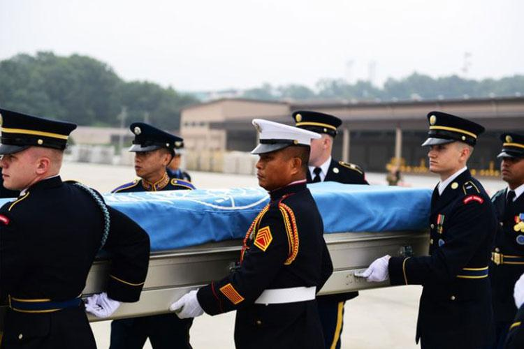 Honor guard from NATO countries participate in a dignified transfer as part of a repatriation ceremony at Osan Air Base, Republic of Korea, June 26, 2020. The United Nations Command in Korea remains committed to enforcing the 1953 UN Armistice Agreement and overseeing activities such as this repatriation. (U.S. Air Force photo by Senior Airman Noah Sudolcan)
