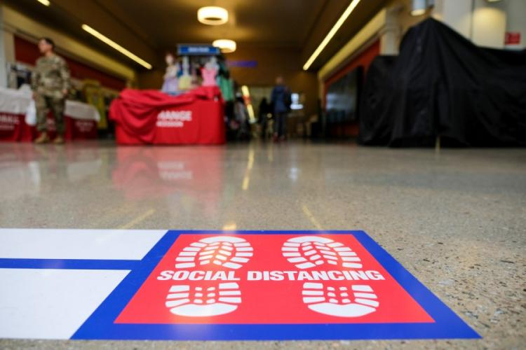 A social distancing decal is posted outside the exchange at Camp Humphreys, South Korea, Friday, March 27, 2020. MATTHEW KEELER/STARS AND STRIPES