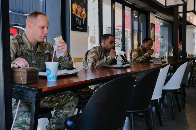 Soldiers assigned to U.S. Forces Korea dine at a restaurant outside Camp Humphreys, South Korea, but continue to maintain social distance on Wednesday, May 20, 2020. MATTHEW KEELER/STARS AND STRIPES