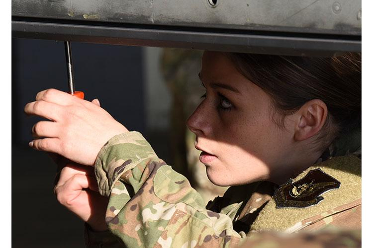 U.S. Air Force Airman 1st Class Kendra Wertsbaugh, 35th Aircraft Maintenance Unit load crew member, loads munitions onto an F-16 Fighting Falcon aircraft during 2020's first 8th Maintenance Group Weapons Load Crew of the Quarter Competition at Kunsan Air Base, Republic of Korea, April 3, 2020. Each team is graded on four categories including a weapons knowledge test, dress and appearance, a tool box inspection and finally, the weapons load. (U.S. Air Force photo by Staff Sgt. Anthony Hetlage)