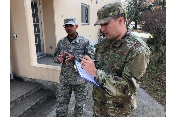 Master Sgt. Adam Brady, right, and Master Sgt. Paul On visited Yokota Air Base eastside housing in Japan on Friday, Feb. 22, 2019, to ask residents about issues with their single-story row homes. (ALLEN ONSTOTT/STARS AND STRIPES)