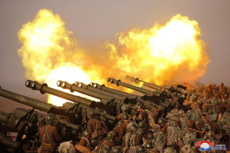 """In this photo released Saturday, March 21, 2020 by the state-run Korean Central News Agency, North Korean troops participate in an artillery fire competition between large combined Army units """"on the western front"""" on Friday, March 20. (KOREAN CENTRAL NEWS AGENCY)"""