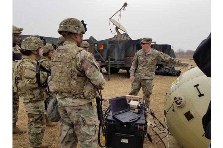 CAMP HUMPHREYS, South Korea - Capt. Zachary Schofield, assistant product manager with Wideband Enterprise Satellite Systems, demonstrates how to use the new Combat Service Support Very Small Aperture Terminal (CSS VSAT) Inflatable Satellite Antenna (ISA) to Soldiers from the 2nd Battalion, 2nd Combat Aviation Brigade maintenance and support company. The CSS VSAT ISA is currently undergoing new equipment training and fielding process in South Korea. (Photo Credit: Amburr Reese)