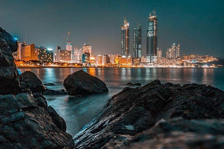 The city of Busan glows on a calm night in March 2019. (Photo Credit: Private First Class Ethan T. Ford)