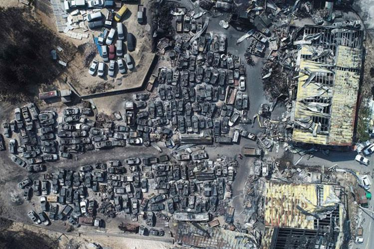 This aerial photo shows burnt vehicles filling a junkyard after being hit by a massive forest fire in Sokcho, South Korea, Friday, April 5, 2019. (KIM DO-HOON/YONHAP VIA AP)
