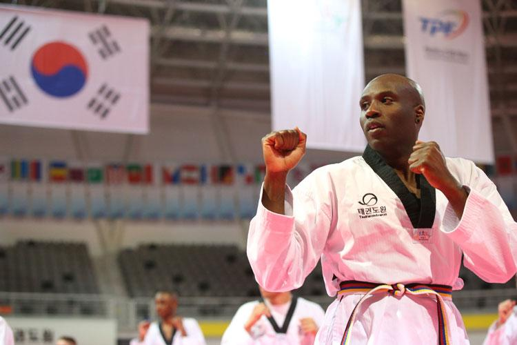 Antwaun Parrish, an U.S. Army Corps of Engineers, Far East District public affairs specialist, conducts Taekwondo training during a cultural exchange event hosted by The Republic of Korea (ROK), Ministry of National Defense at Taekwondowon, Muju, South Korea, April 9-11. (Photo by Antwaun Parrish)