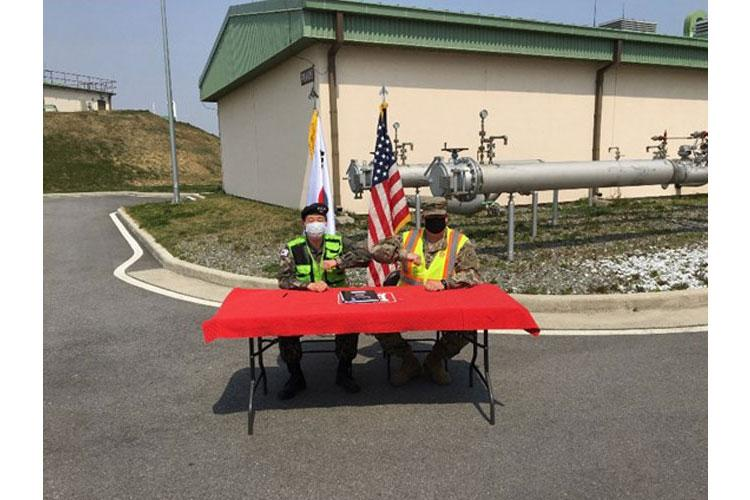 Col. Lee Woo Sig (left), Ministry of National Defense U.S. Forces Relocation Office DCA, and Col. Garrett Cottrell (right), Deputy Commanding Officer - Transformation, United States Army Corps of Engineers Far East District, sign the Acceptance Release Memorandum for the OS030 Phase I Fuel Oil Facility, Camp Humphreys, South Korea, Apr. 16.