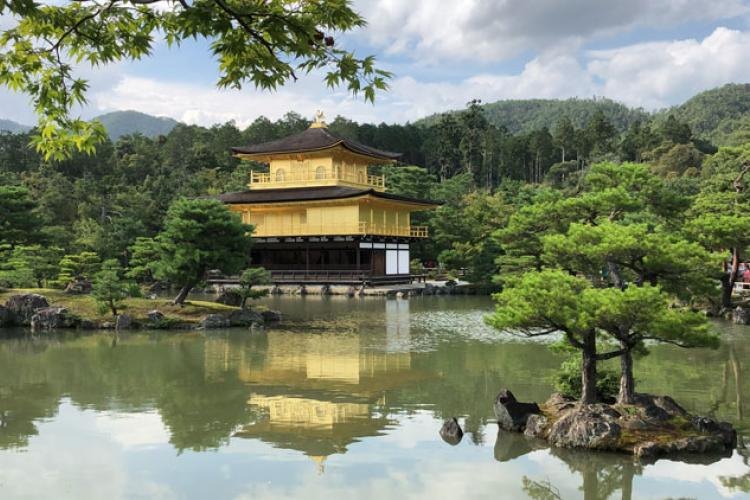 Kinkakuji (Golden Pavilion) - Designated a UNESCO World Heritage site, the Golden Pavillion and its garden were fashioned to represent the Buddhist's earthly paradise. The gorgeous, golden exterior is striking against the dark green forest and blue water pond in the garden surrounding it.